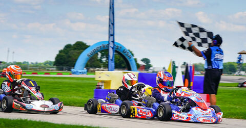 Asher Ochstein drives his Benik Kart past the checkered flags at the 2020 SKUSA Summernationals